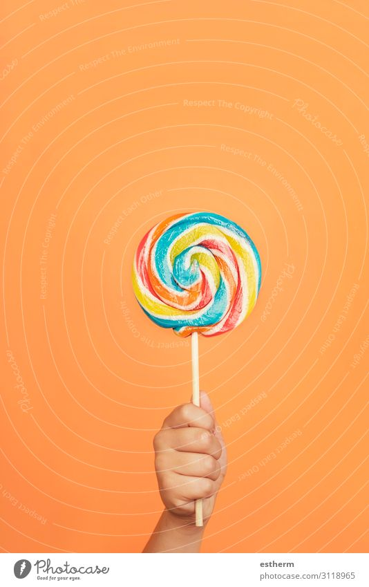 Child's hand with Colorful lollipop Food Dessert Candy Nutrition Eating Joy Human being Masculine Infancy Hand Fingers 1 8 - 13 years To hold on Feeding Healthy