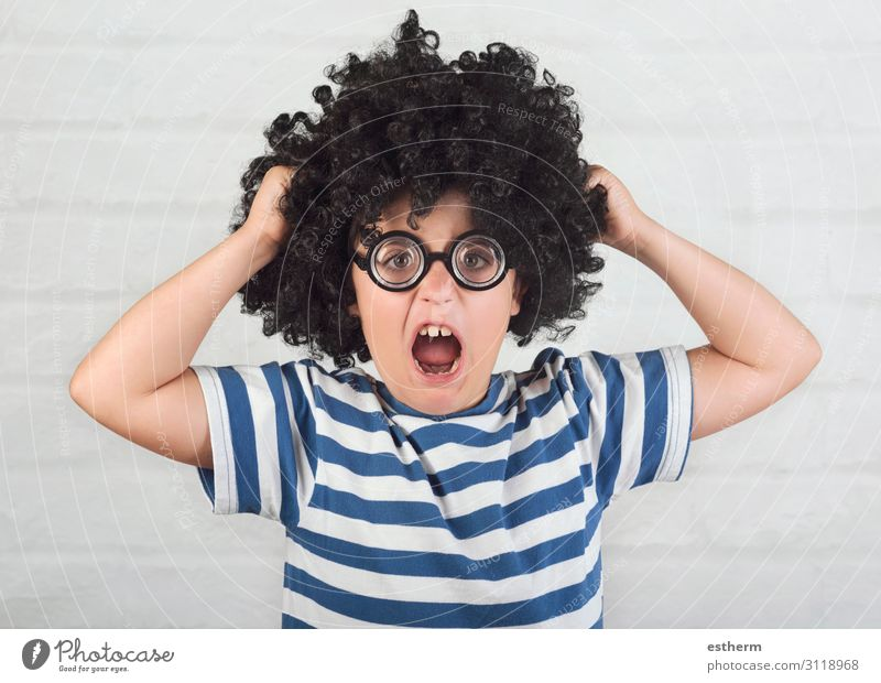 angry boy wearing nerd glasses who pulls his hair Lifestyle Human being Masculine Infancy 1 8 - 13 years Child Eyeglasses Wig To hold on Sadness Funny
