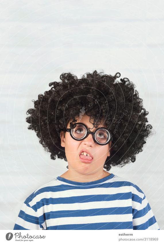 funny child making a grimace wearing nerd glasses Lifestyle Face Playing Human being Masculine Child Infancy 1 8 - 13 years Eyeglasses Wig Think Fitness Funny