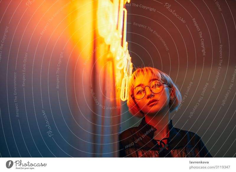Asian female wearing glasses in front of neon light sign Asians Blonde Eyeglasses Woman Young woman Girl Lighting Illumination Light (Natural Phenomenon)
