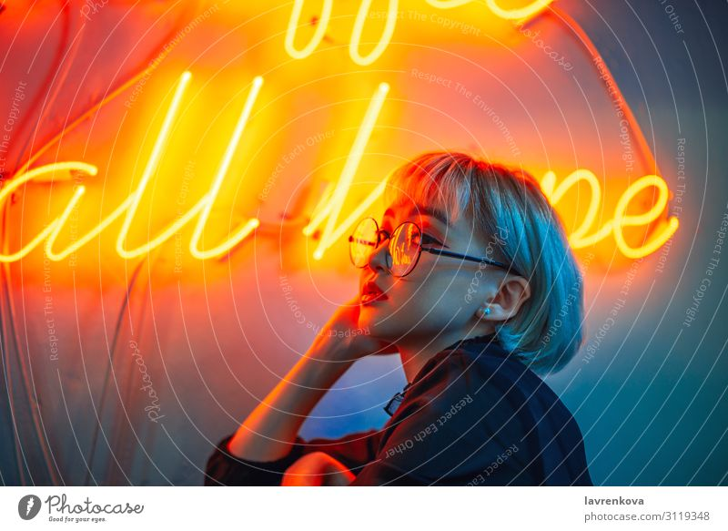 Asian female wearing glasses in front of neon light sign Neon light Asians Woman Young woman Youth (Young adults) 18 - 30 years Eyeglasses Light Lighting