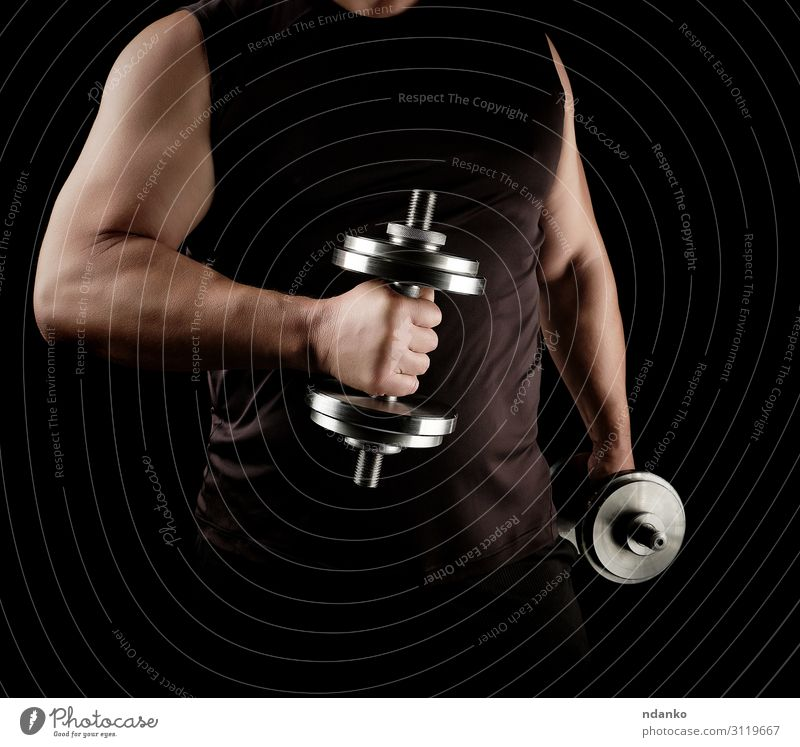 man in black clothes holds steel dumbbells Human being Man Hand Black Lifestyle Adults Sports Power Stand Action Arm Fitness Athletic Strong Steel Muscular