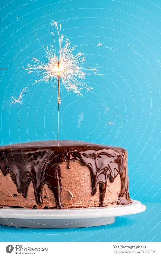Chocolate glazed birthday cake with a sparkler. New year cake Lighting Feasts & Celebrations Copy Space Delicious Dessert Sugar Home-made Tasty Sparkler Minimal