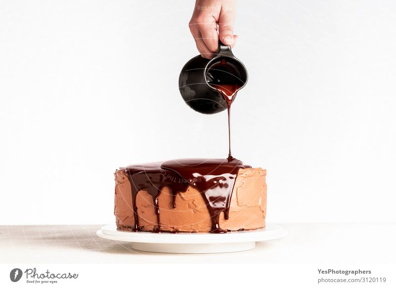 Pouring chocolate over layered cake. Dripping melted chocolate Christmas & Advent Hand Feasts & Celebrations Birthday Table Delicious Kitchen Cake Dessert