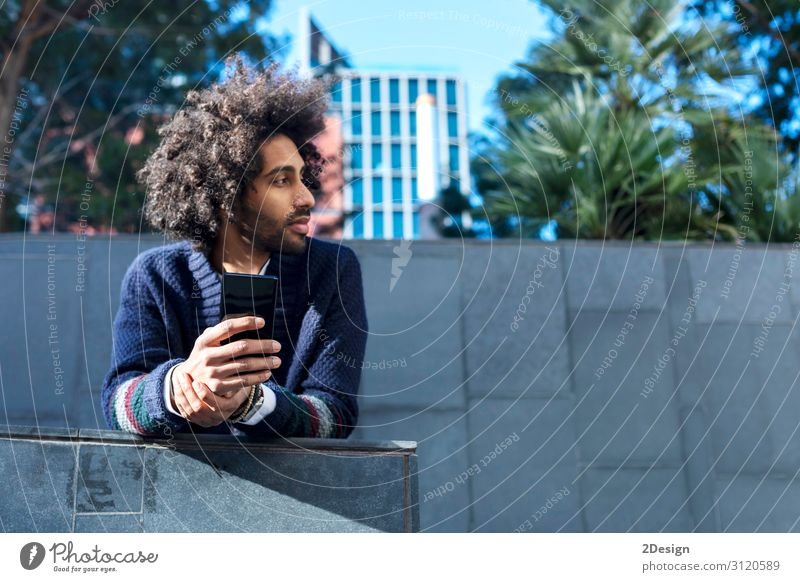 Portrait of handsome afro man using his phone Lifestyle Style Happy Leisure and hobbies Telephone Cellphone Technology Human being Masculine Young man