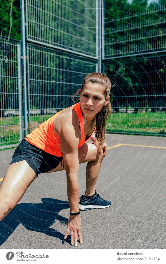 Sportswoman doing leg stretches Lifestyle Personal hygiene Body Summer Human being Woman Adults Brunette Fitness Athletic Authentic Self-confident Energy