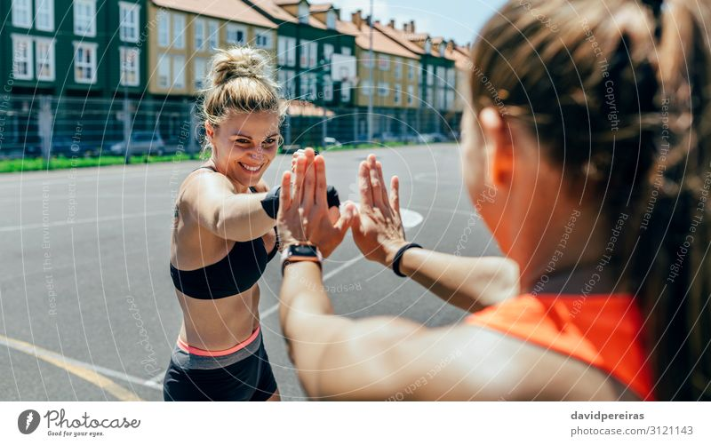 Sportswoman training boxing with her trainer Lifestyle Happy Beautiful Human being Woman Adults Friendship Hand Gloves Fitness Smiling Athletic Authentic Thin