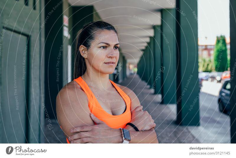 Sportswoman posing with crossed arms Lifestyle Beautiful Personal hygiene Human being Woman Adults Piercing Brunette Fitness Athletic Natural Strong Pride