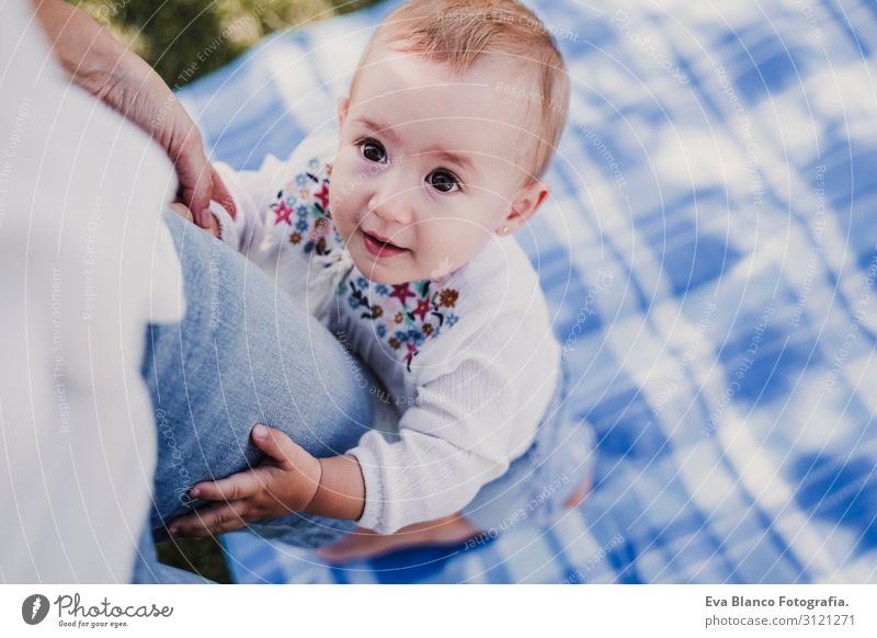 young mother playing with baby girl outdoors in a park Woman Child Human being Nature Youth (Young adults) Young woman Summer Blue Colour Beautiful Green White