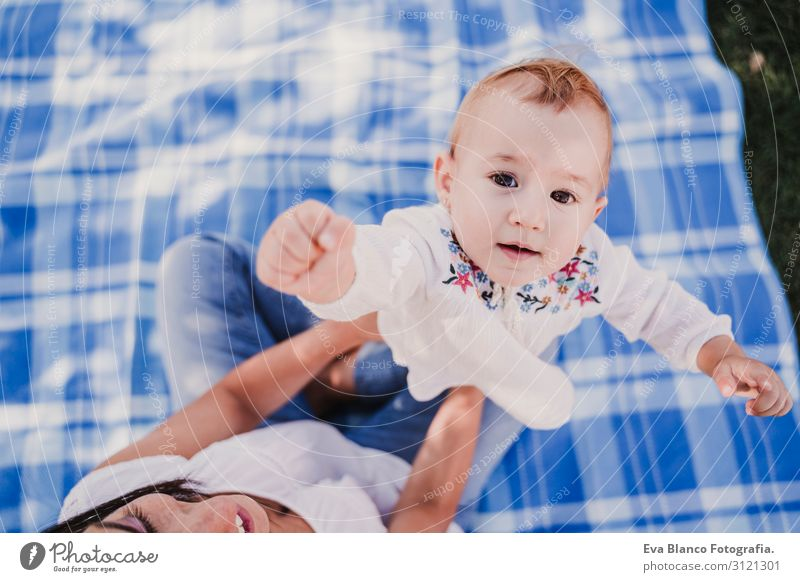 young mother playing with baby girl outdoors in a park Woman Child Human being Vacation & Travel Youth (Young adults) Young woman Summer Blue Beautiful White
