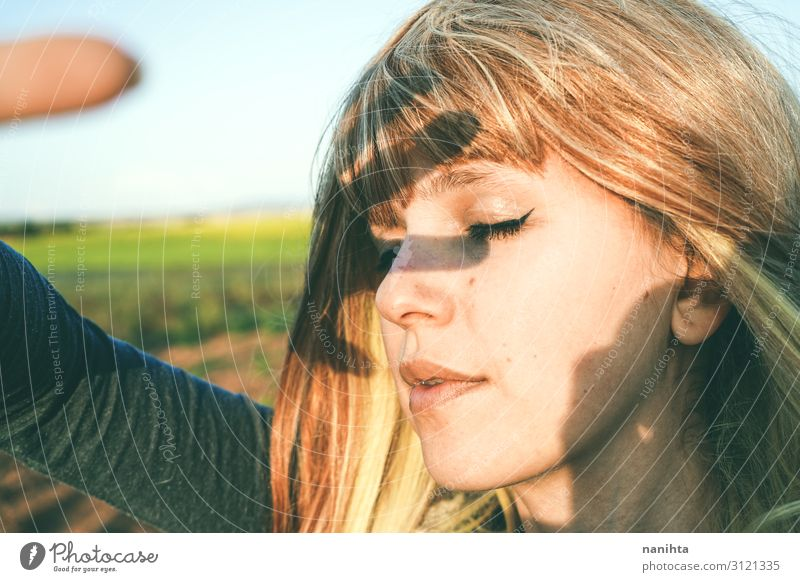 Young woman covering from sun with her hand Woman Human being Youth (Young adults) Summer Beautiful White Hand Sun Loneliness 18 - 30 years Face Lifestyle