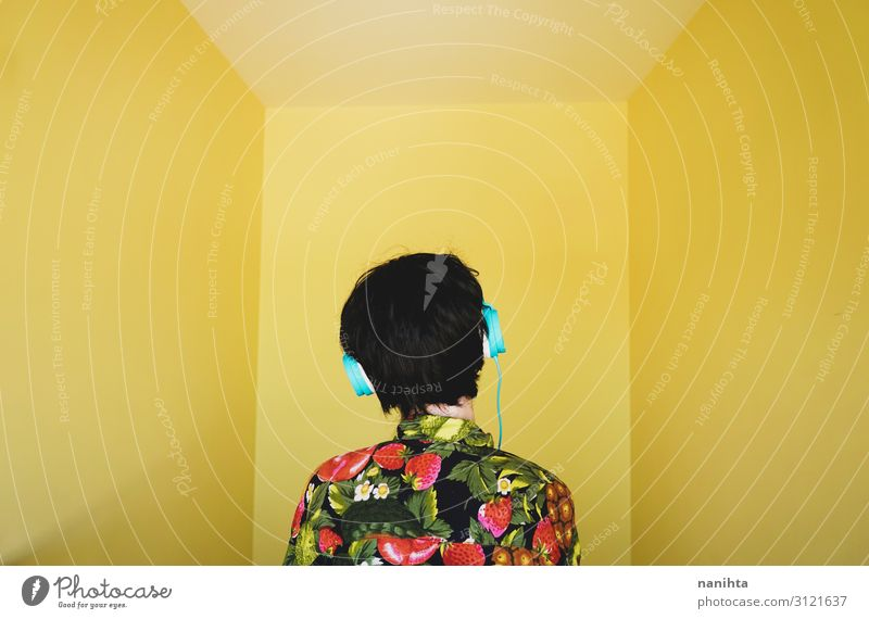 Cool young androgynous dj woman Woman Human being Youth (Young adults) Colour Joy 18 - 30 years Lifestyle Adults Yellow Style Art Hair and hairstyles Retro