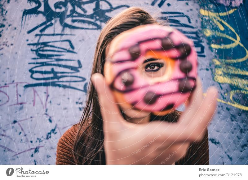 A beautiful woman's eye through a donut Human being Youth (Young adults) Young woman Beautiful Food photograph 18 - 30 years Adults Warmth Feminine Retro Round