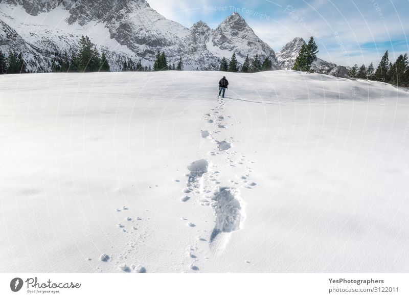 Snow footprints in the Alps mountains. Winter wandering scenery Adventure Mountain Hiking Christmas & Advent New Year's Eve Man Adults Nature Landscape