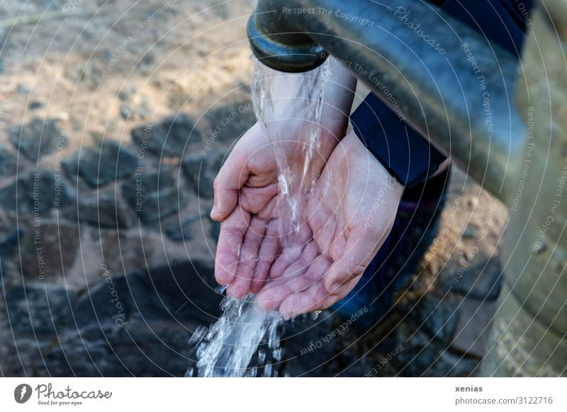Fingertip sensitivity / Hands on the water pump Drinking water Young woman Youth (Young adults) Woman Adults Fingers 1 Human being Water Climate change Wet Blue