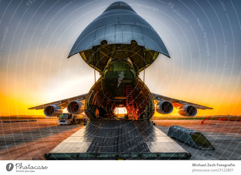 antonov an-124 on the ground with wide open freight room Vacation & Travel Sun Industry Logistics Business Technology Sky Airport Transport Vehicle Airplane