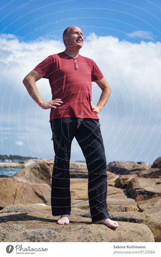 vacation Human being Masculine Man Adults 1 45 - 60 years Nature Sky Summer Beautiful weather Coast Clothing T-shirt Pants Stone Observe Looking Stand Simple