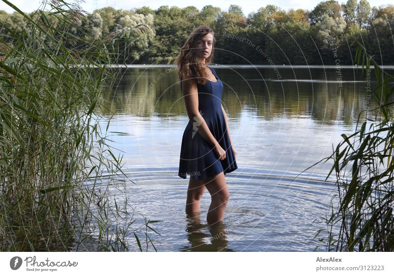 Portrait of a young, tall woman standing in an idyllic lake Lifestyle Style already Wellness Trip Adventure Summer vacation Young woman Youth (Young adults)