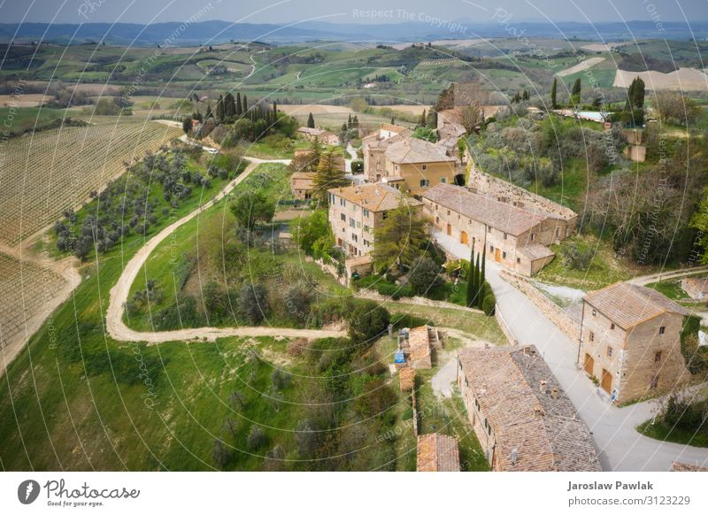 The tiny town of Lucignano d'Asso, taken from above, flying a drone. lucignano stone building nobody village italy europe ancient house medieval tuscany old