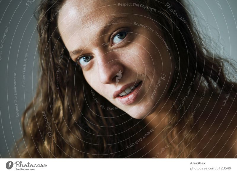 Portrait of a young woman with curly brunette hair Lifestyle Style Joy already Well-being Young woman Youth (Young adults) Hair and hairstyles Face