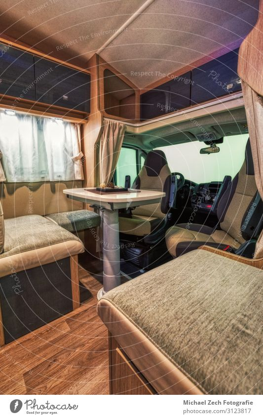 Modern interior of a new motorhome at the Suisse Caravan Salon Lifestyle Luxury Style Design Vacation & Travel Tourism Trip Freedom Camping Furniture Table