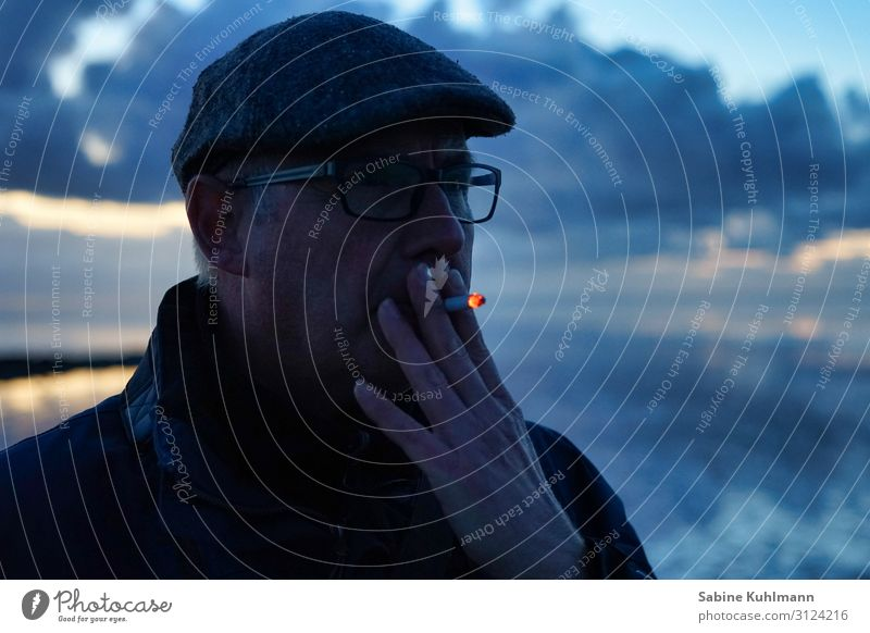 Another cigarette Human being Masculine Man Adults 1 45 - 60 years Cap Smoking Contentment Calm Feeble Addiction Colour photo Exterior shot Copy Space right