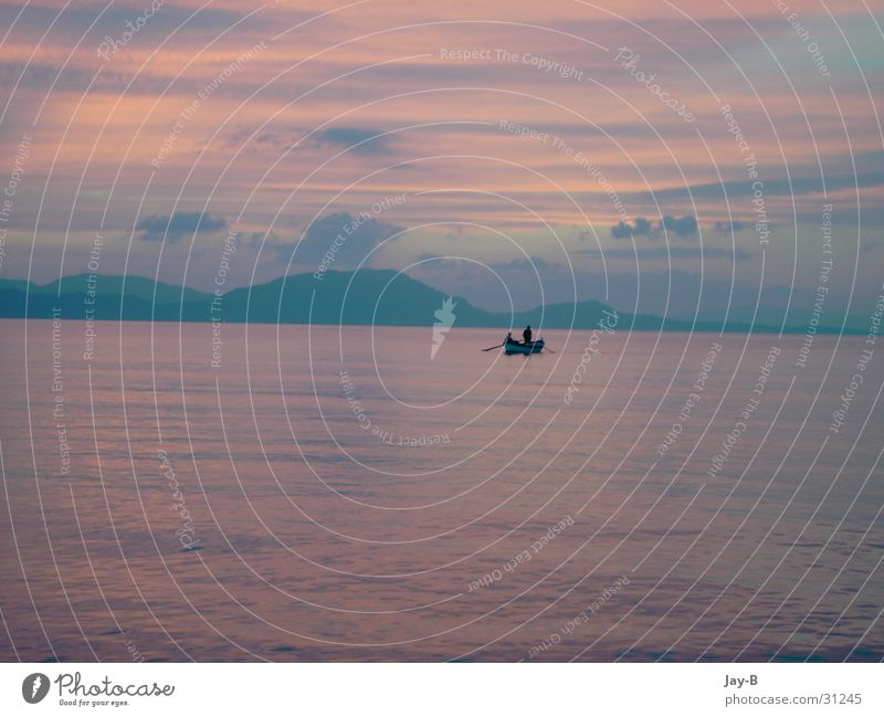Corfu Sundown Sunset Play of colours Watercraft Fisherman Fishing boat Romance Clouds Ocean Greece Colour Mountain cirrostratus clouds