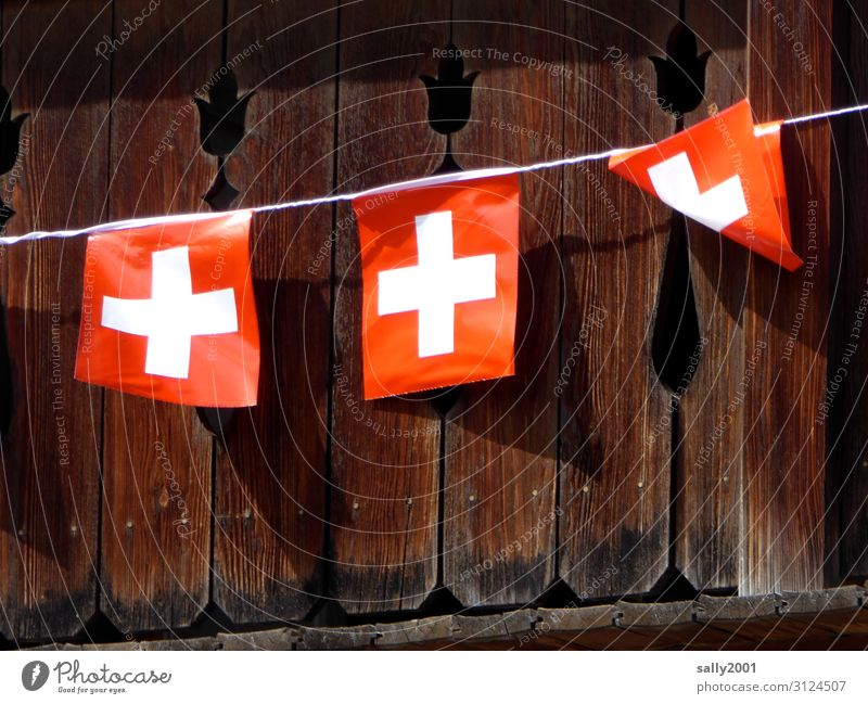 Flags in the wind... Wind Switzerland Swiss flag Hut Balcony Tourism Ensign Symbols and metaphors Rope fold Blown away Flying the flag Gust of wind Colour photo