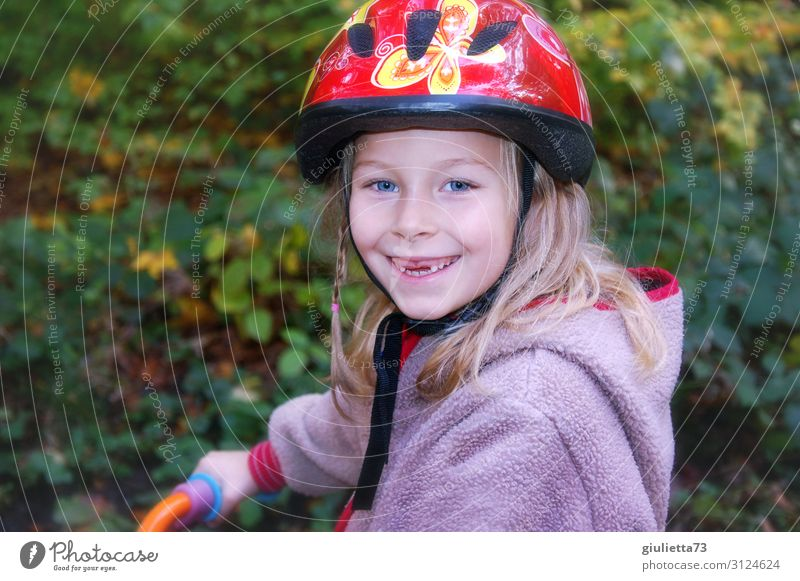 More fun with safety | girls with gaps in their teeth and bicycle helmet Playing Girl Infancy 1 Human being 3 - 8 years Child Autumn Park Bicycle impeller
