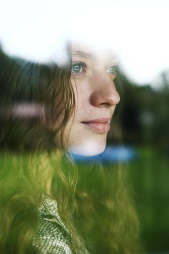 Portrait of a young woman behind a window pane Lifestyle Style already Well-being Young woman Youth (Young adults) 18 - 30 years Adults Landscape