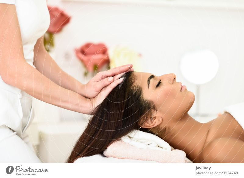 Woman receiving head massage in spa wellness center. Lifestyle Happy Beautiful Body Skin Face Health care Medical treatment Wellness Relaxation Spa Massage