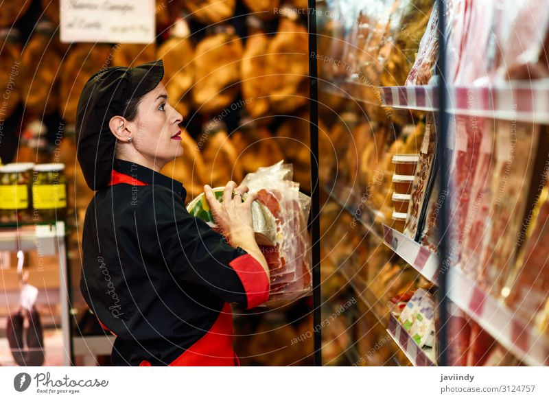 Portrait of female worker taking products in butcher shop Food Meat Cheese Shopping Work and employment Profession Business Human being Feminine Young woman