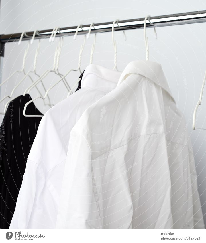 white men's crumpled shirts hanging on a metal hanger Shopping Masculine Fashion Clothing Shirt Dress Hang Clean White Home many wrinkled service wear rack