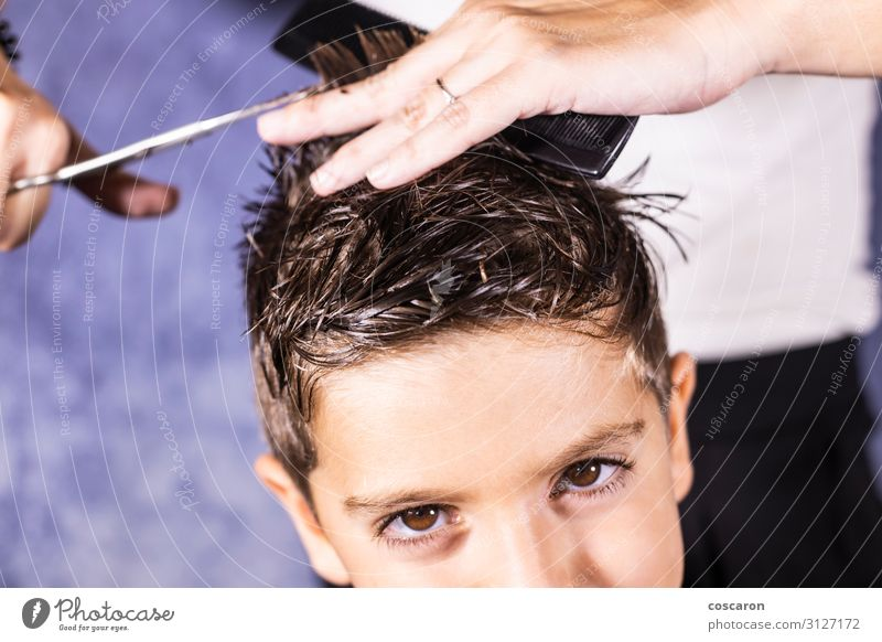 Beautiful boy getting a haircut with scissors Lifestyle Style Personal hygiene Hair and hairstyles Children's room Work and employment Profession Hairdresser