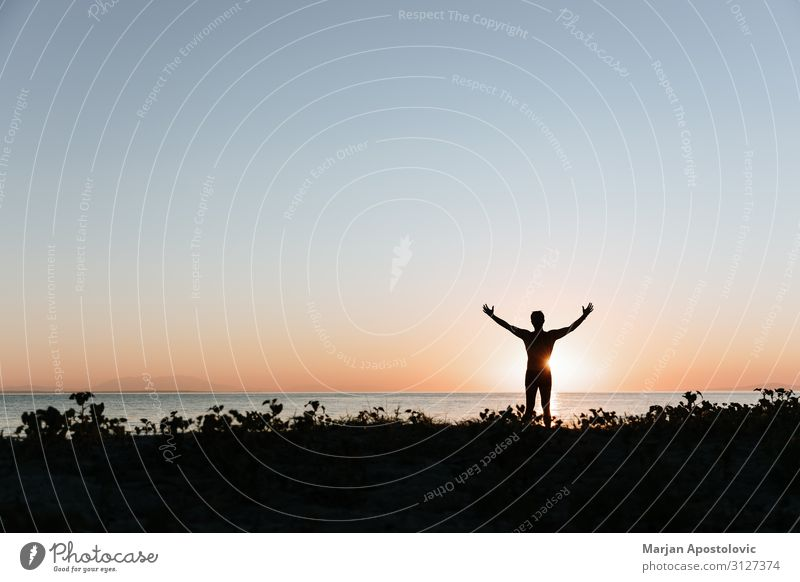 Silhouette of a man on the beach Lifestyle Exotic Joy Wellness Harmonious Relaxation Calm Vacation & Travel Tourism Adventure Freedom Summer vacation Beach