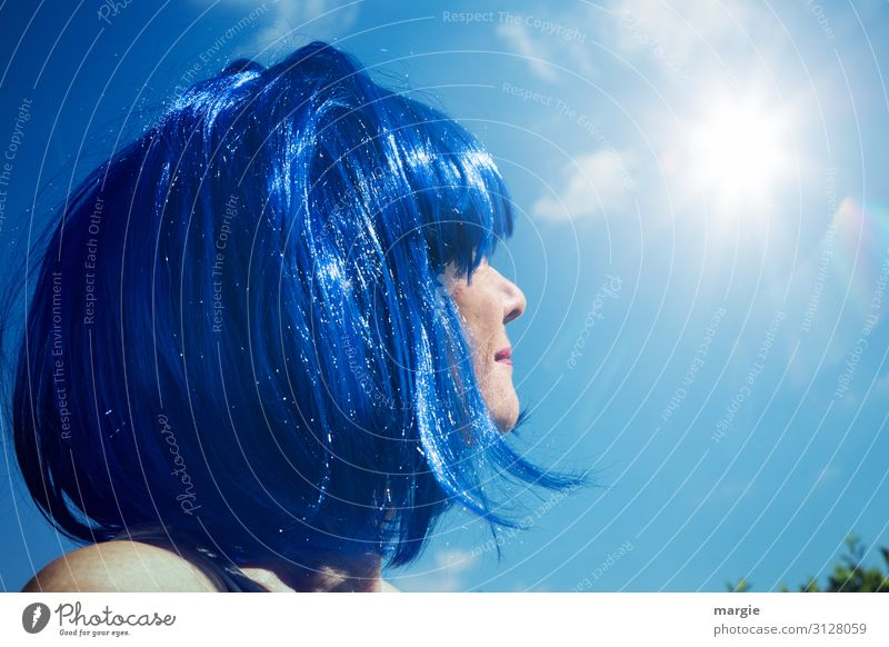 A woman with blue hair is looking at the blue sky and the sun Woman Face of a woman Sunlight Sky Hair and hairstyles Blue Blue sky Reflection Light Sunbeam