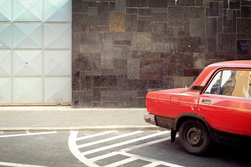 red car Town Capital city House (Residential Structure) Wall (barrier) Wall (building) Facade Street Vehicle Car Retro Trashy Red Gate Parking Budapest