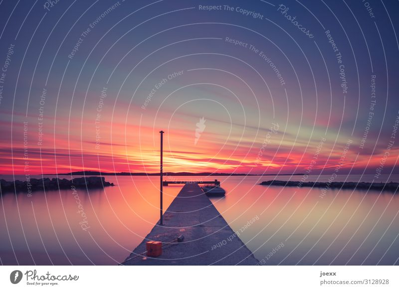 Long jetty by the sea at intense sunset Sunset Footbridge Ocean Beautiful weather Summer tranquillity Evening Exterior shot Colour photo relaxation Twilight