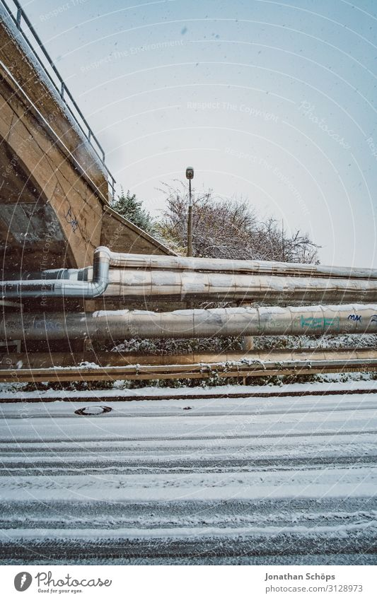 Wide-angle industrial winter landscape with snowflakes Street Winter Aqueduct Bridge Cold Freedom Frozen Industrial Exterior shot Iron-pipe Snow Snowflake