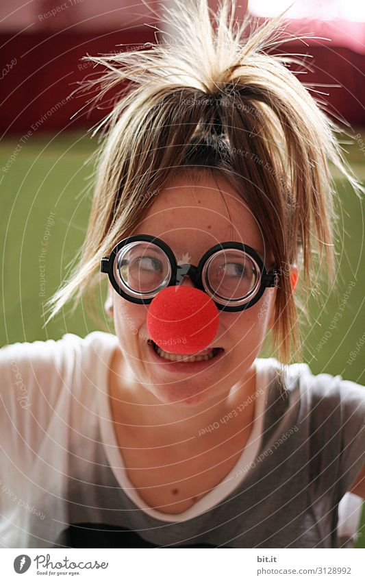 Girl with horn-rimmed glasses and red clown nose Playing Children's game Party Feasts & Celebrations Carnival Birthday Human being Feminine Young woman