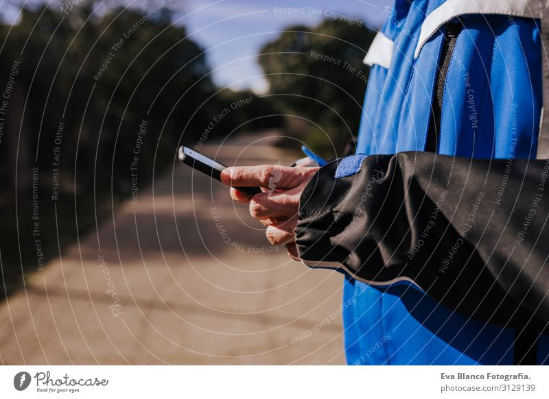 caucasian man using mobile phone outdoors in nature. sunny day Nature Adventure American discovering backpacker traveler Green To enjoy westerner hiker