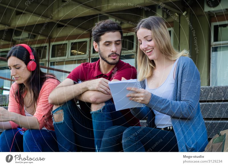 Group of University students studying together at the building of university. Education concept Lifestyle Happy Beautiful Summer School Study Academic studies