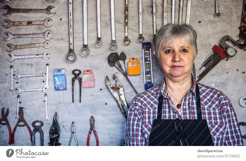 Female carpenter in his workshop Craft (trade) Business Human being Woman Adults Old Authentic Carpenter Mature tool board Organized background carpentry