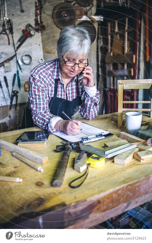 Female carpenter in his workshop Craft (trade) Business To talk Hammer Human being Woman Adults Wood Old Authentic Carpenter senior mobile Custom-made waist up