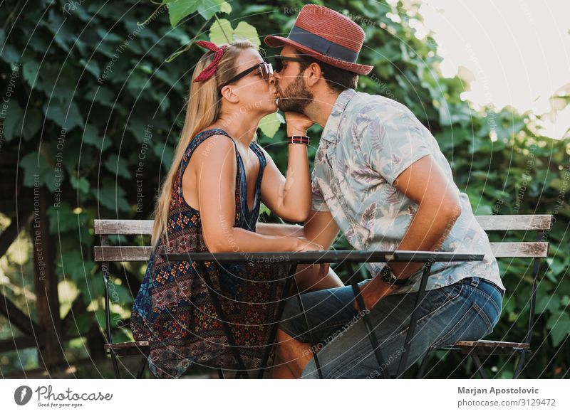 Couple in love kissing on the terrace Lifestyle Joy Flirt Valentine's Day Masculine Feminine Young woman Youth (Young adults) Young man Woman Adults Man Partner