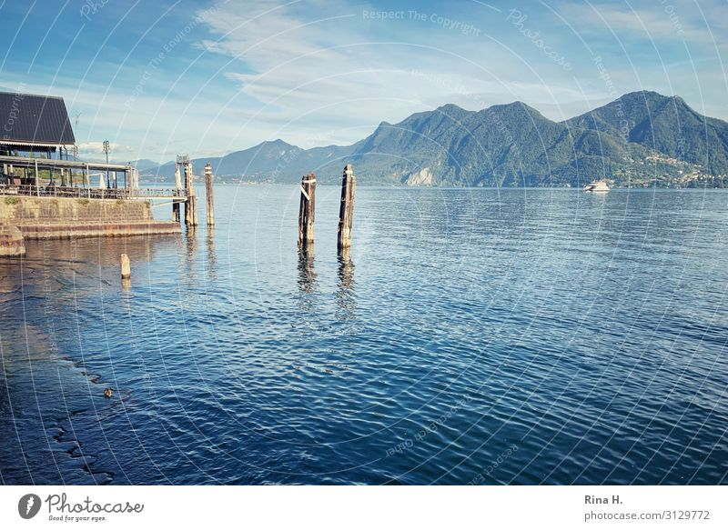 Sky Vacation & Travel Nature Blue Landscape Sun Relaxation Mountain Lifestyle Autumn Lake Trip Beautiful weather Italy Village Jetty