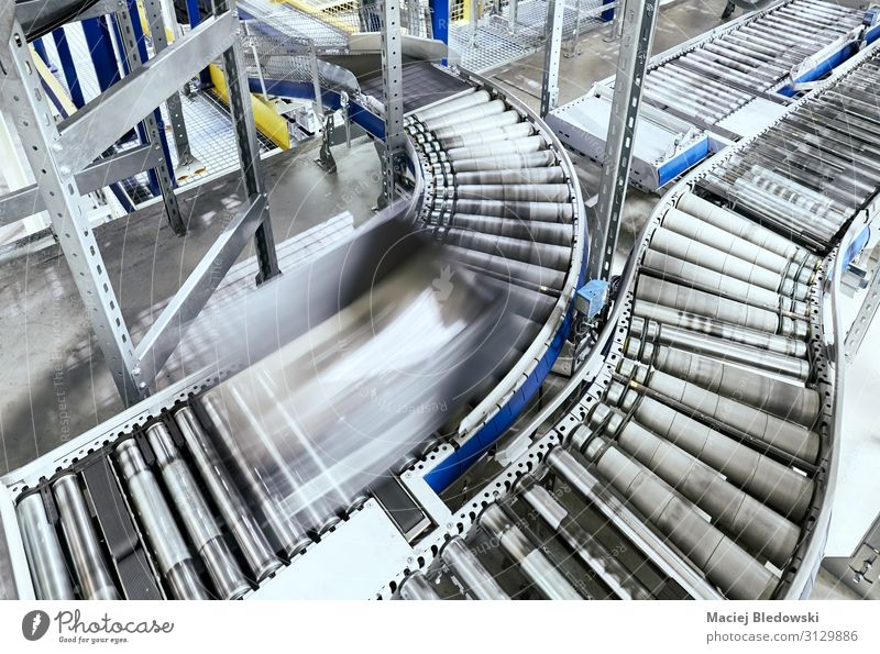 Transportation line conveyor roller with container in motion Workplace Factory Industry Logistics Services Business Machinery Technology Line Movement Modern