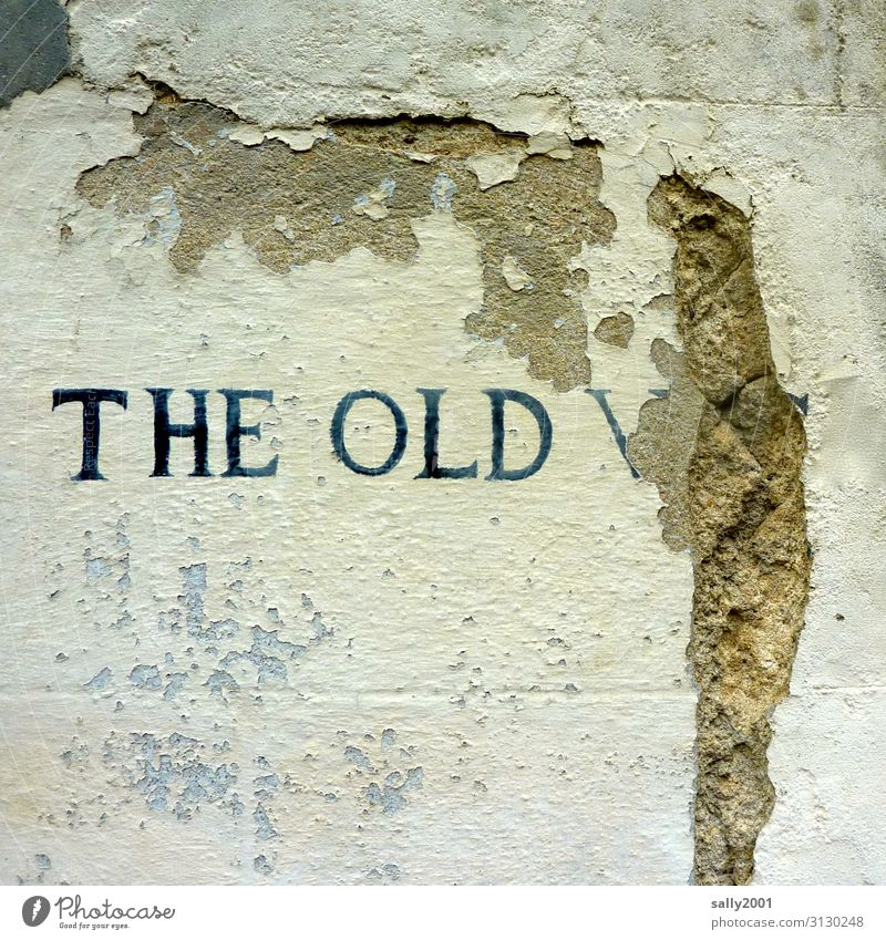 literally | old... Old writing English Language Word Inscription the old Facade shattered fall apart Wall (barrier) masonry White Flake off