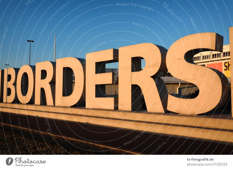 Open borders - The wall is leaking! Architecture Wall (barrier) Wall (building) Stone Sign Characters Signage Warning sign Threat Gigantic Tall Blue Brown