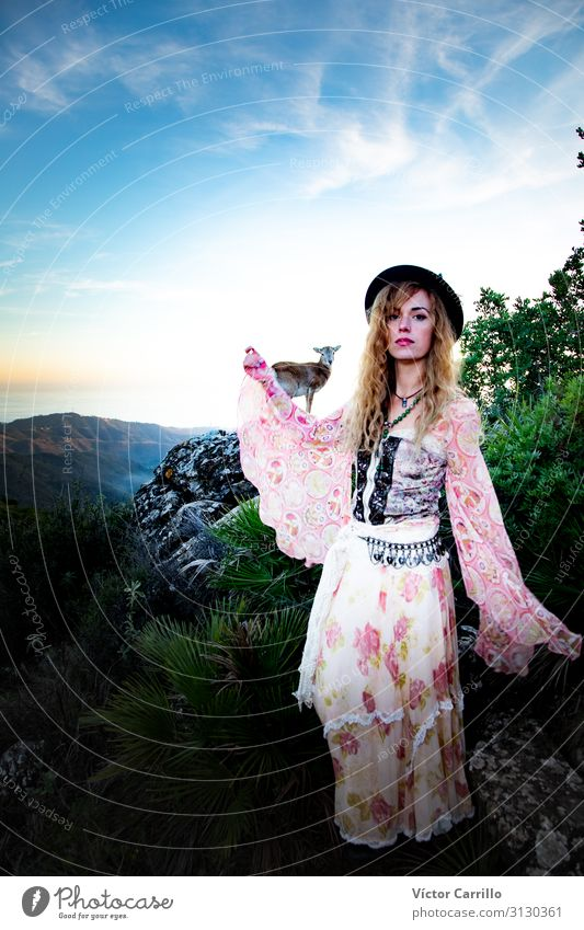 A young blonde boho woman with a deer Human being Feminine Young woman Youth (Young adults) Woman Adults 1 18 - 30 years Nature Landscape Plant Animal Emotions